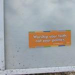Worship sticker on sign